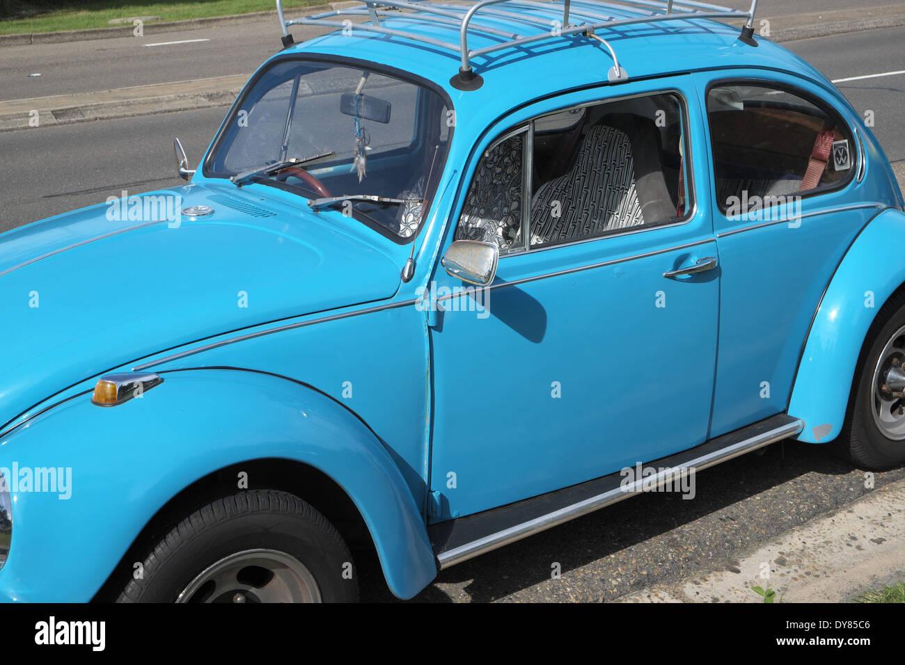 classic vw beetle on pittwater road,sydney,australia - Stock Image