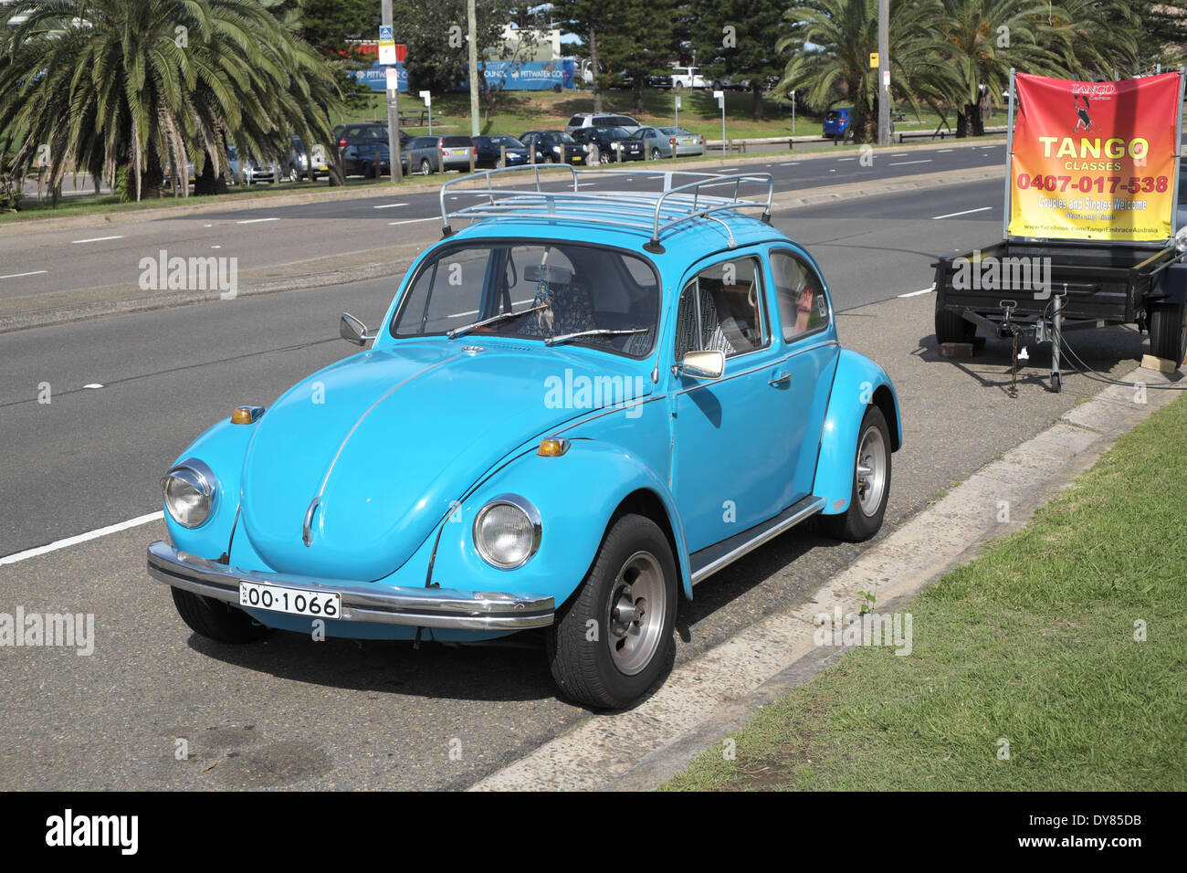 classic vw beetle on pittwater road,sydney,australia - Stock Image