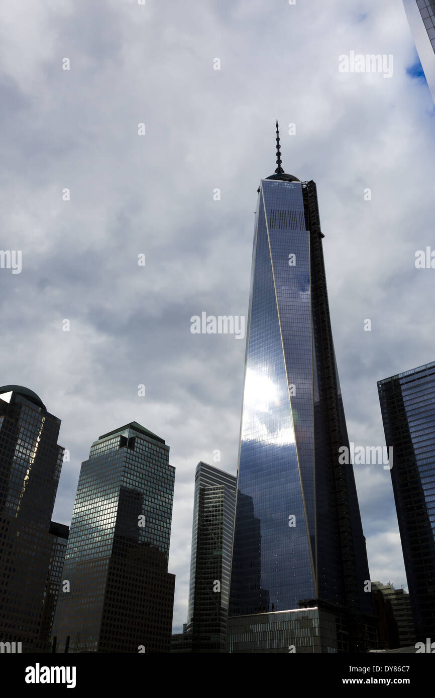 Storm clouds over One World Trade Center also 1 World Trade Center or 1 WTC, dubbed the Freedom Tower during initial basework, Manhattan, New York USA - Stock Image
