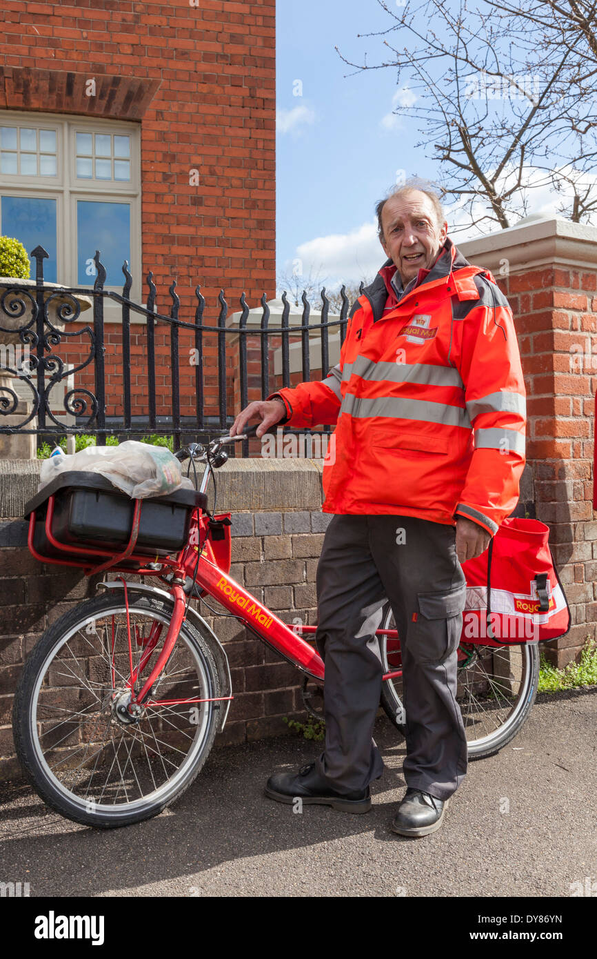 Village postman with his bike, Plumtree, Nottinghamshire, England, UK - Stock Image