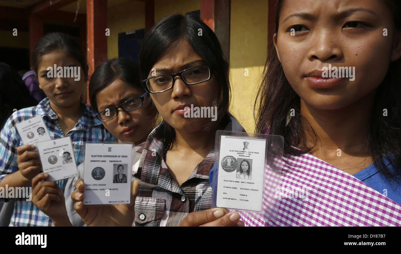 Meghalaya, India. 9th Apr, 2014. Voters display their voter identity cards outside a polling station during the second phase of Indian general elections in northeastern state of Meghalaya, India, April 9, 2014. Credit:  Stringer/Xinhua/Alamy Live News - Stock Image