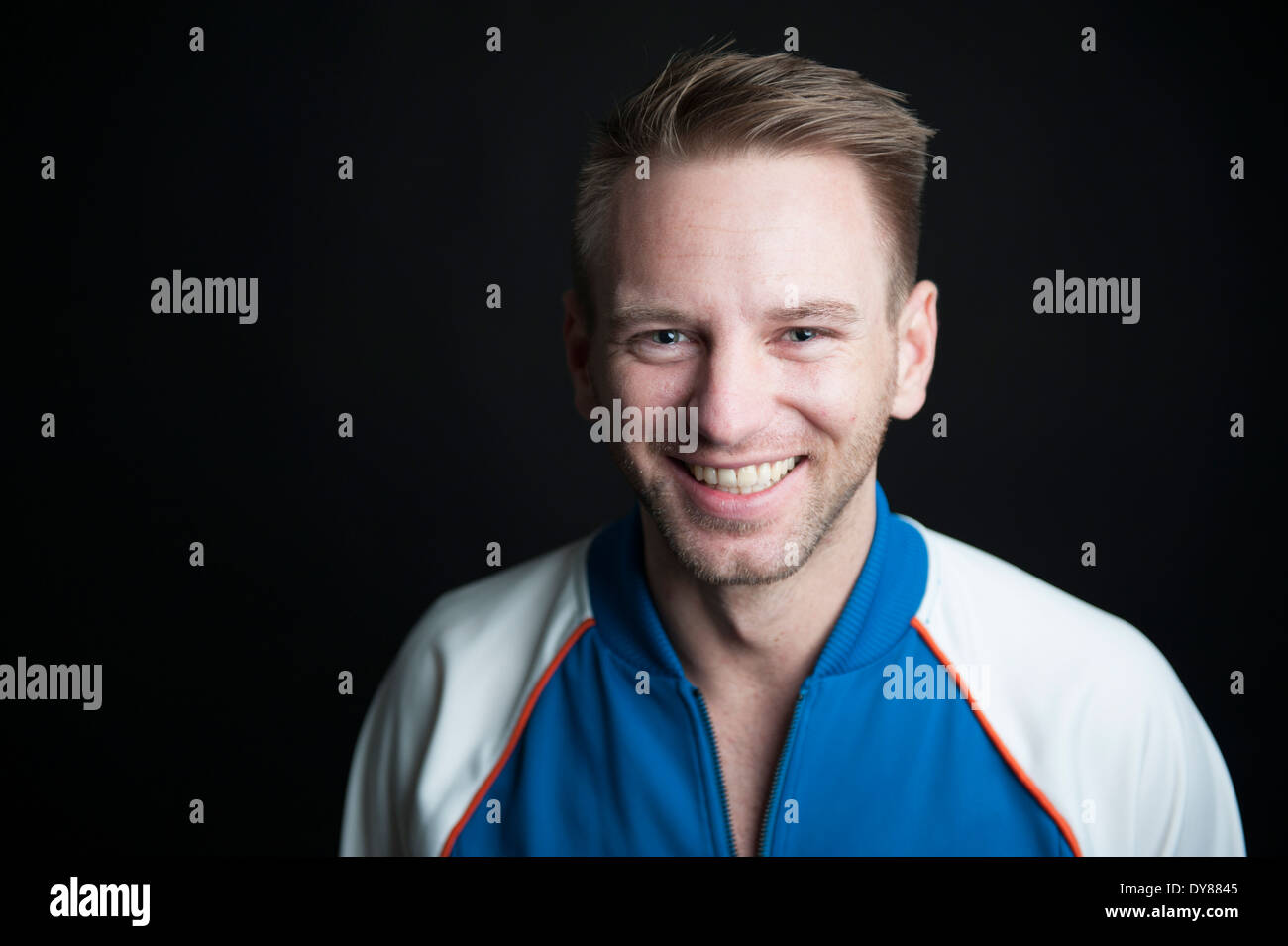 Smiling young man, portrait - Stock Image