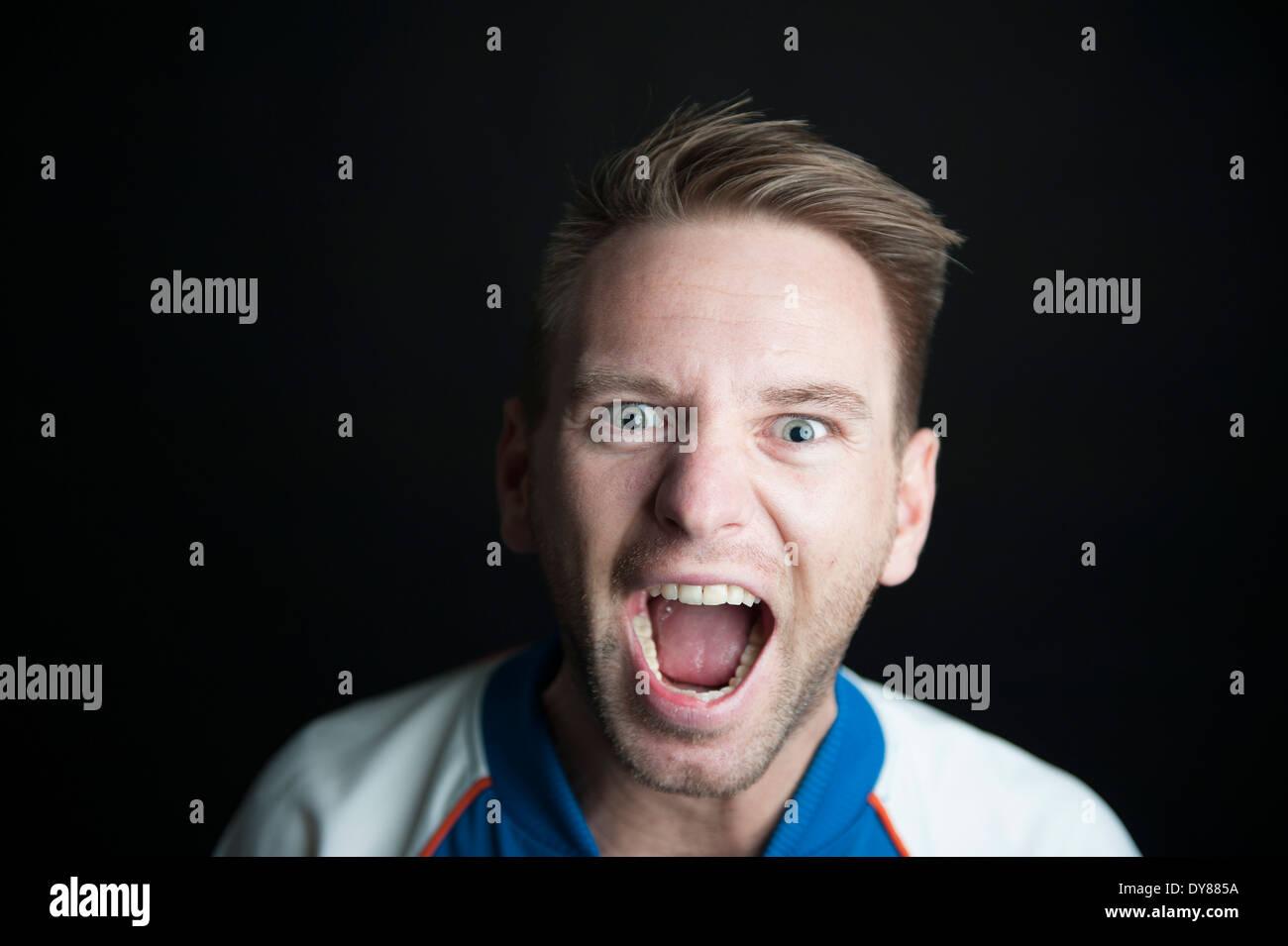 Shouting man, portrait - Stock Image