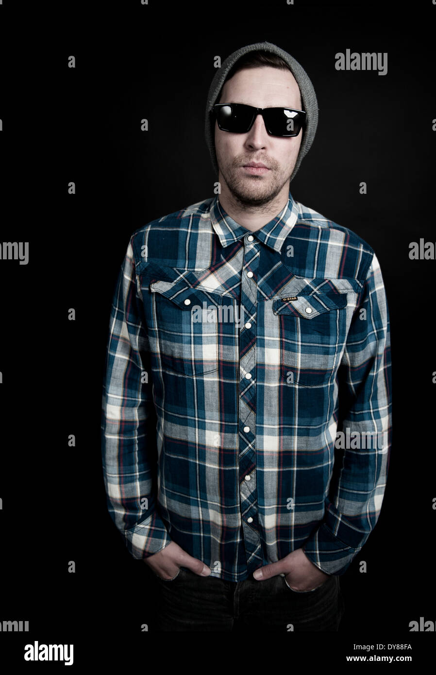 Young man with hat and sunglasses - Stock Image