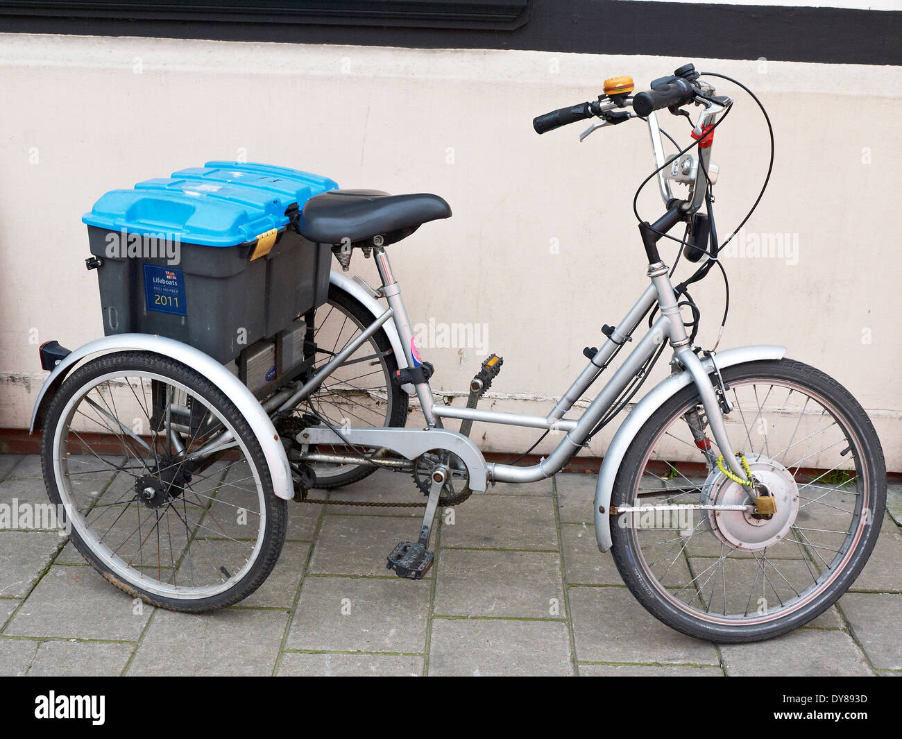 Tricycle parked on pavement UK - Stock Image