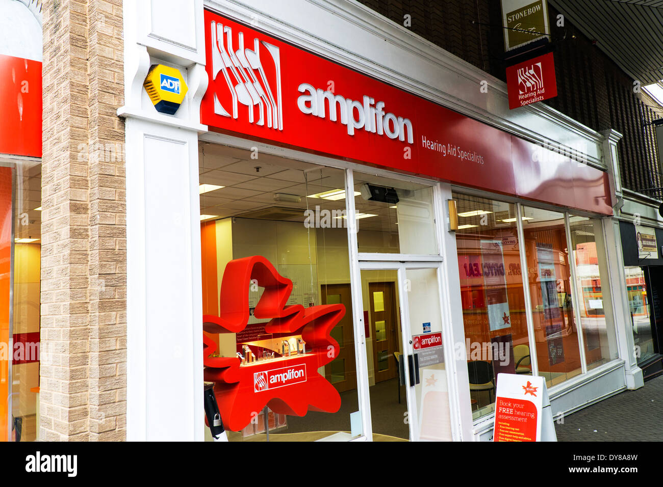 Amplifon hearing aid shop specialists outside exterior facade front Lincoln City Lincolnshire UK GB England - Stock Image