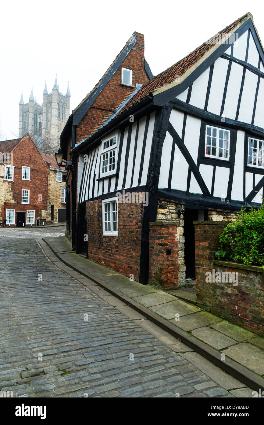 Lincoln City Tudor House U0026 Cathedral In Background On Steep Hill  Lincolnshire UK GB England