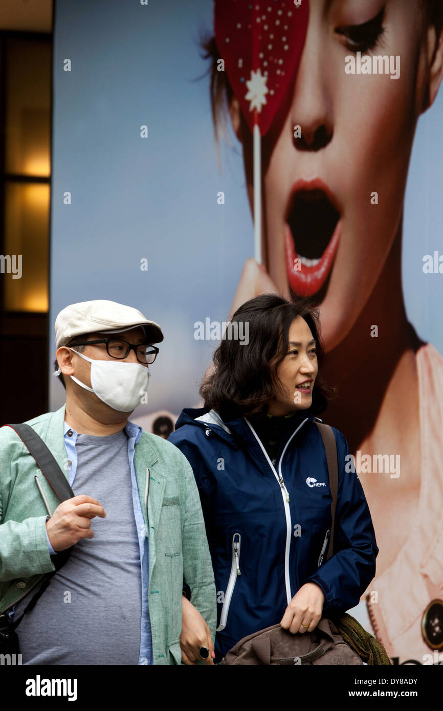Prague tourists wearing pollution mask in the street Czech Republic - Stock Image