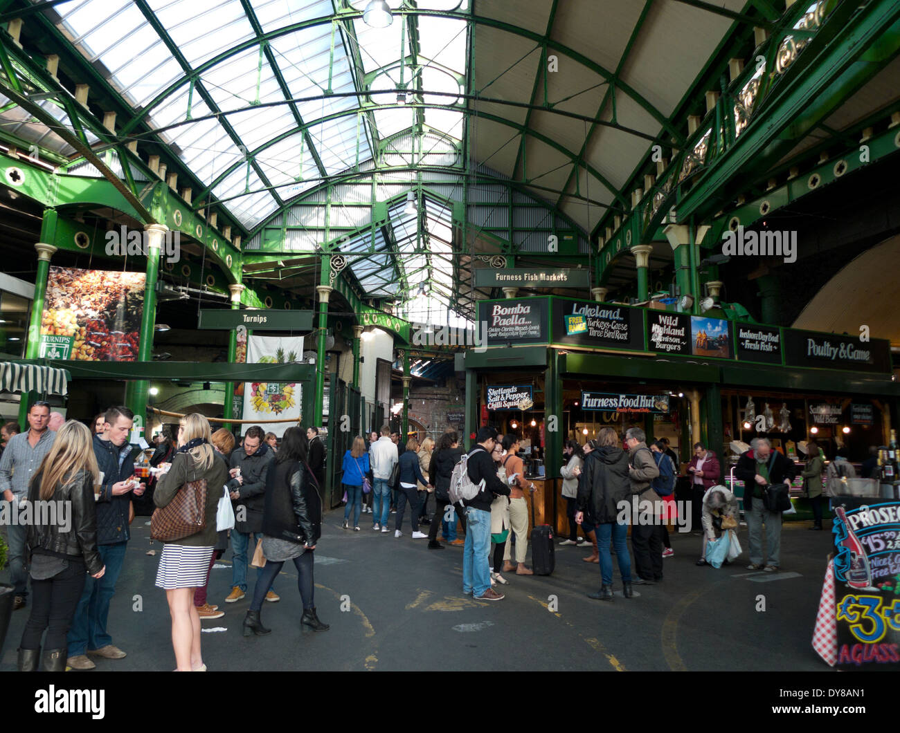 Interior view of people at food stalls in Borough Market, London Bridge, London, UK  KATHY DEWITT - Stock Image