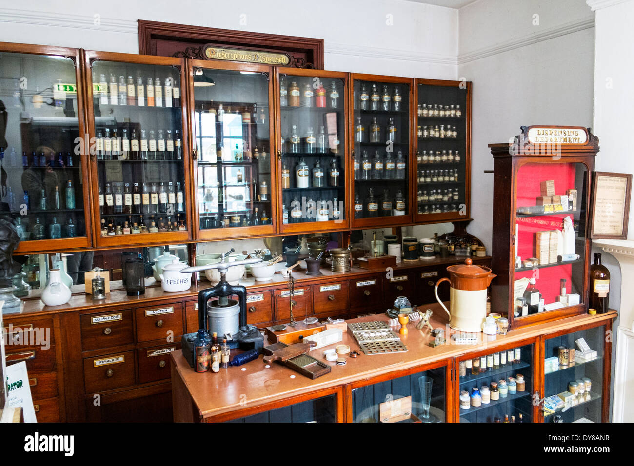 Victorian chemist shop lotions and potions on shelves health treatment Lincoln City Lincolnshire UK GB England Stock Photo