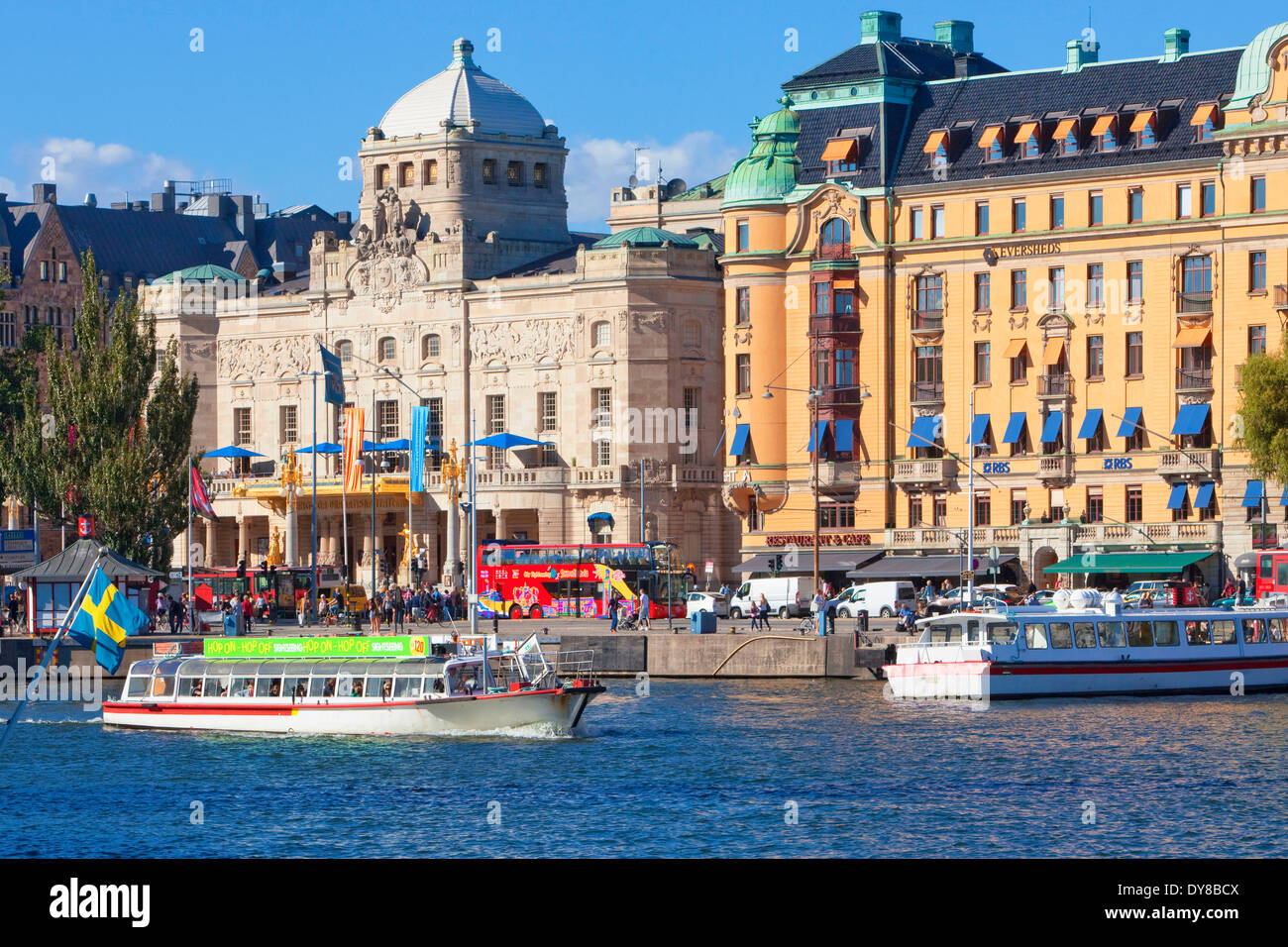 boat capital cities city day Dramaten Europe ferry flag harbour Nordic Nybroviken outdoors people Royal Dramatic - Stock Image