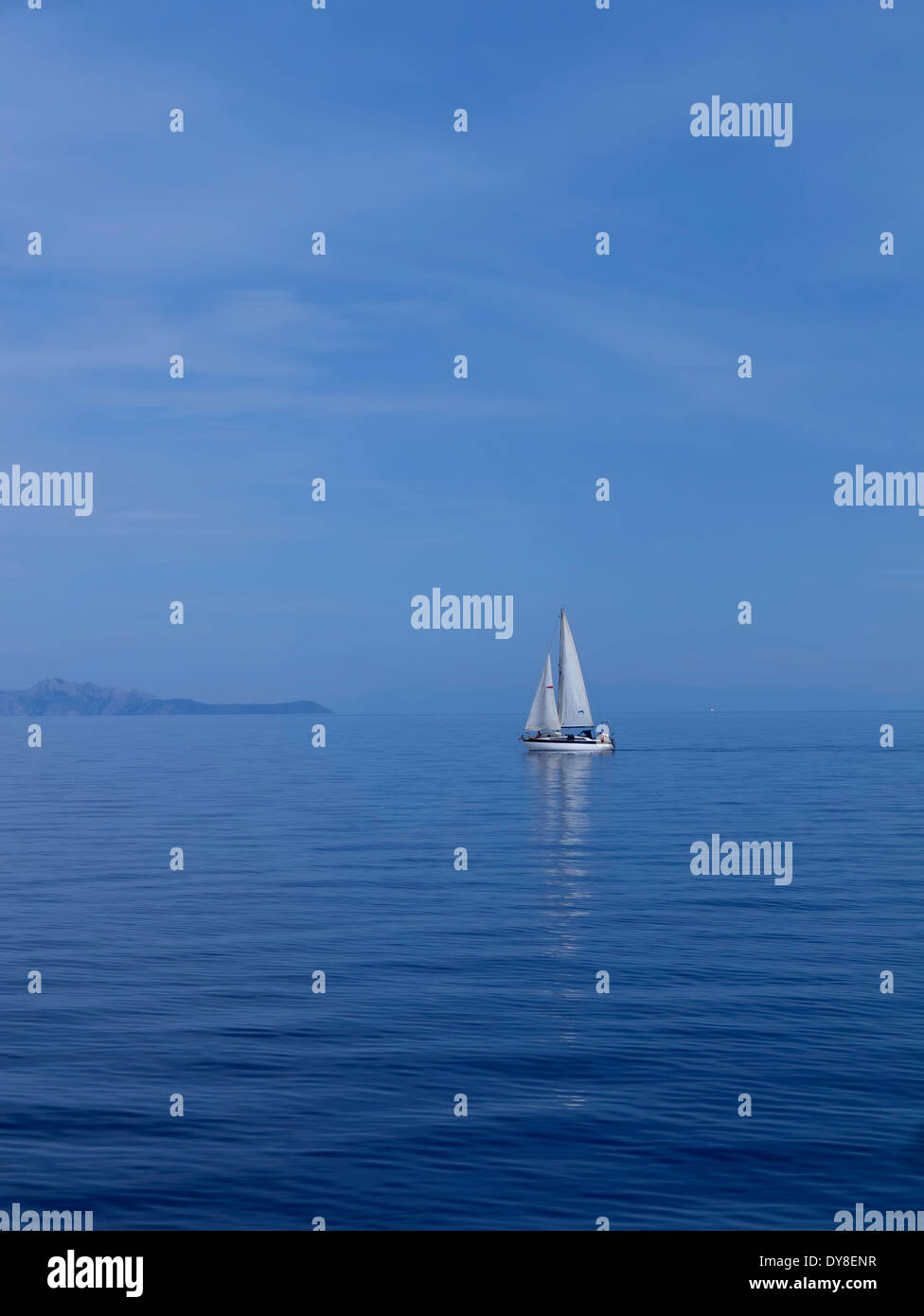 Yacht sailing reflecting into Ionian sea Greece - Stock Image