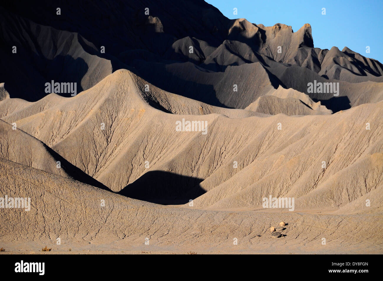 The eroded shale badlands of North Caineville Mesa in Utah's San Rafael Desert. - Stock Image