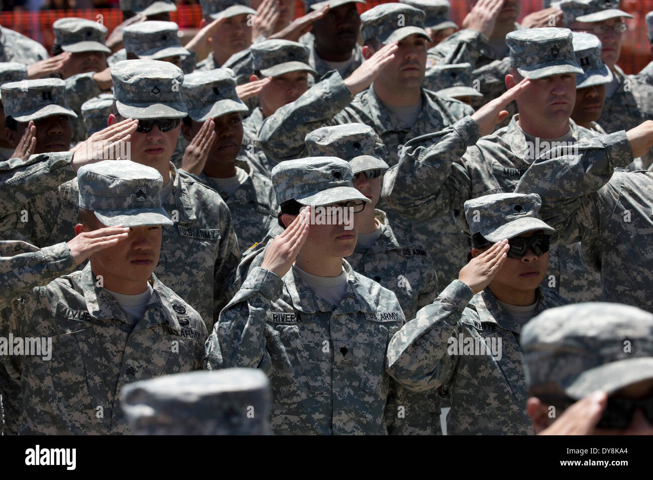 U.S. Army soldiers salute during memorial service for fellow soldiers killed in shooting at Fort Hood Army Post in Texas - Stock Image