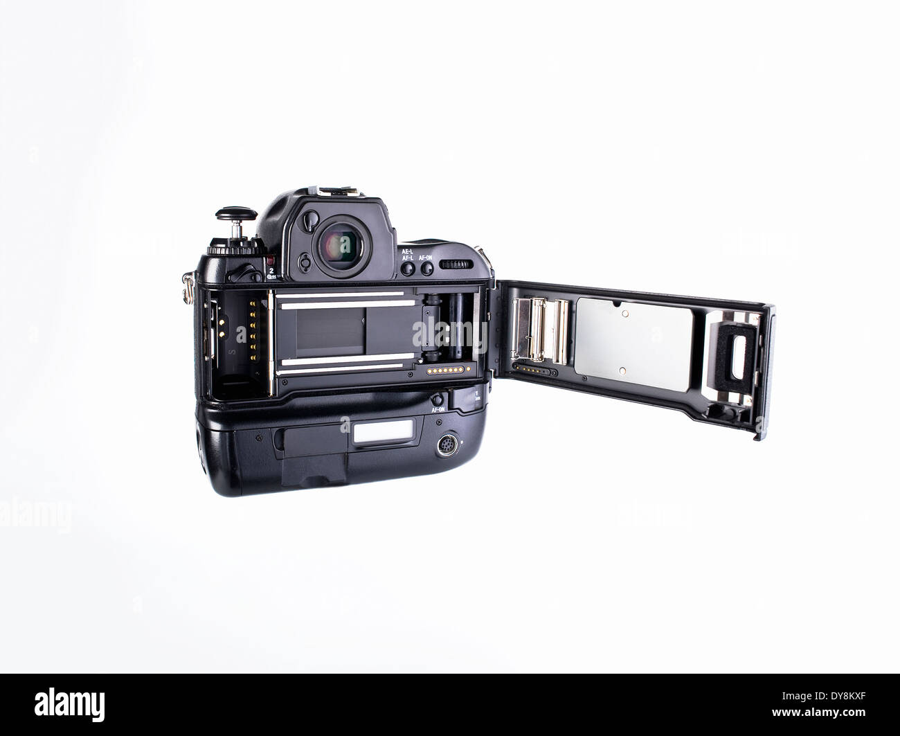 The back of a professional 35mm film camera with film loading door open to show film compartment and shutter - Stock Image
