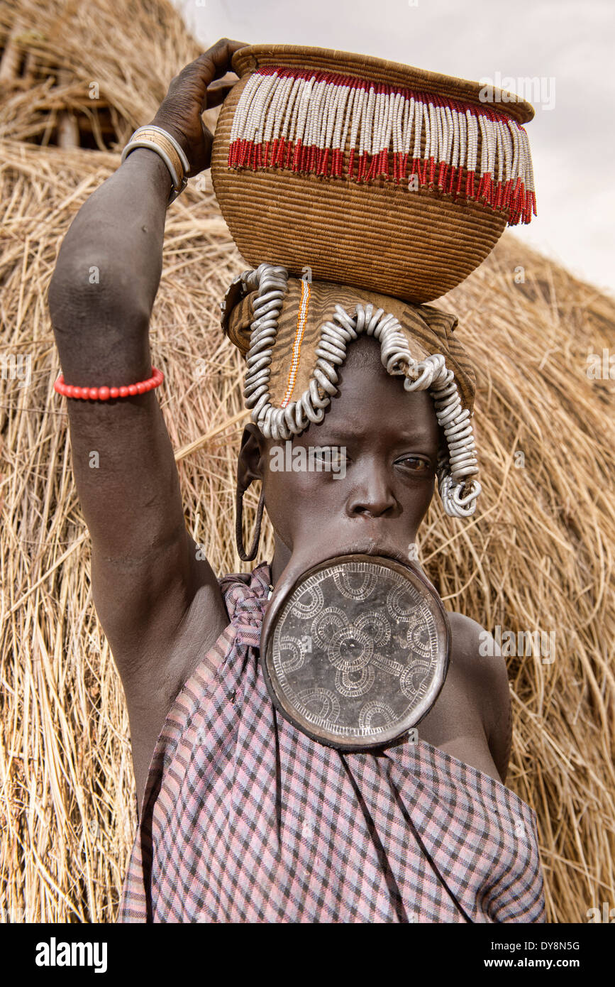Mursi woman with lip plate in the Lower Omo Valley of Ethiopia. - Stock Image
