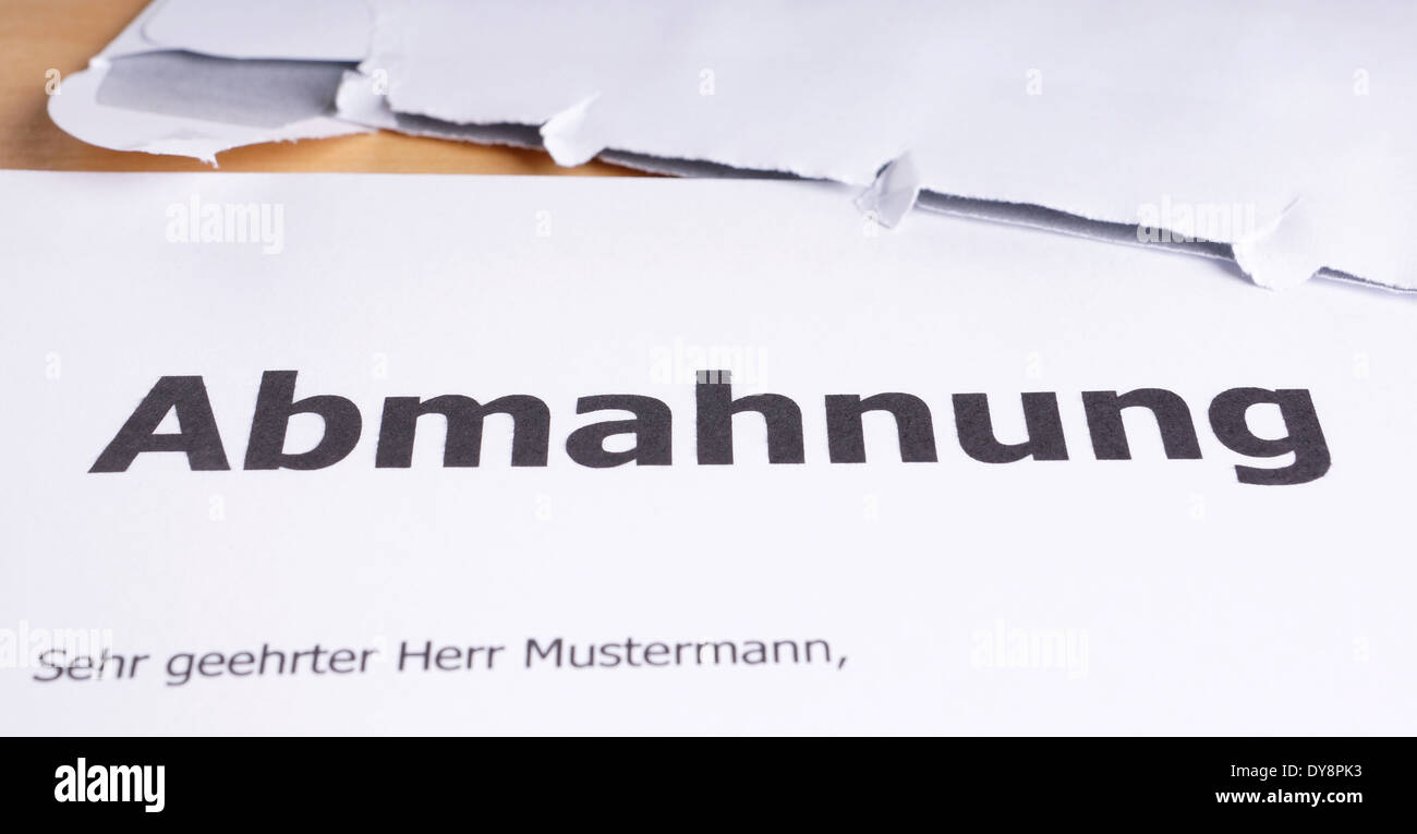 an Abmahnung is a German written warning similar to a cease-and-desist letter - Stock Image