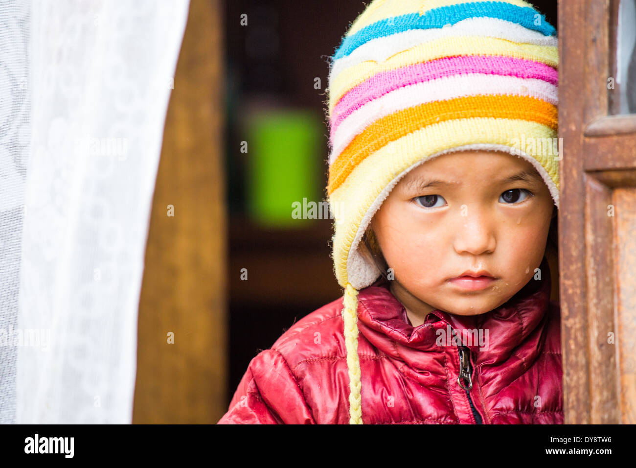 Young Napali boy in a doorway in Kathmandu, Nepal - Stock Image