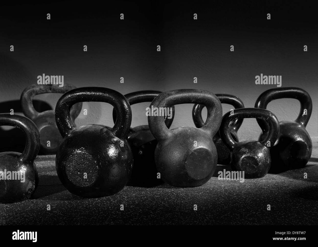 Kettlebells weights in a workout gym in black and white - Stock Image