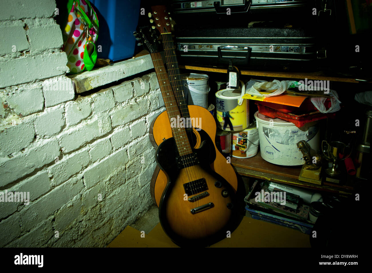 Pair of old guitars stored in cellar Stock Photo: 68422693