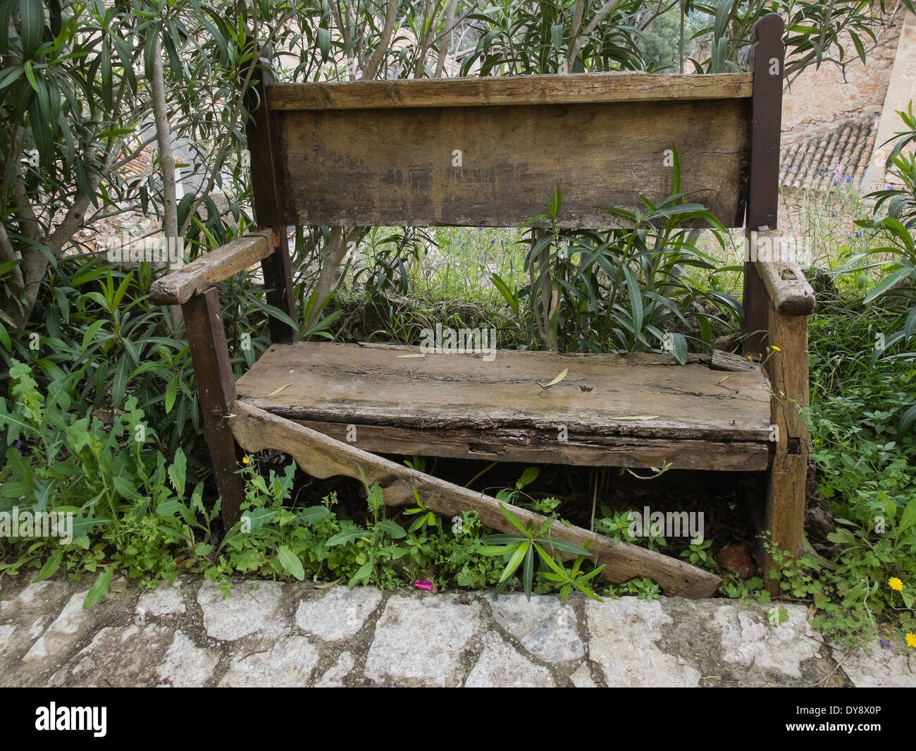 Old Wooden Bench Left In A Street, Miravet, Spain   Stock Image