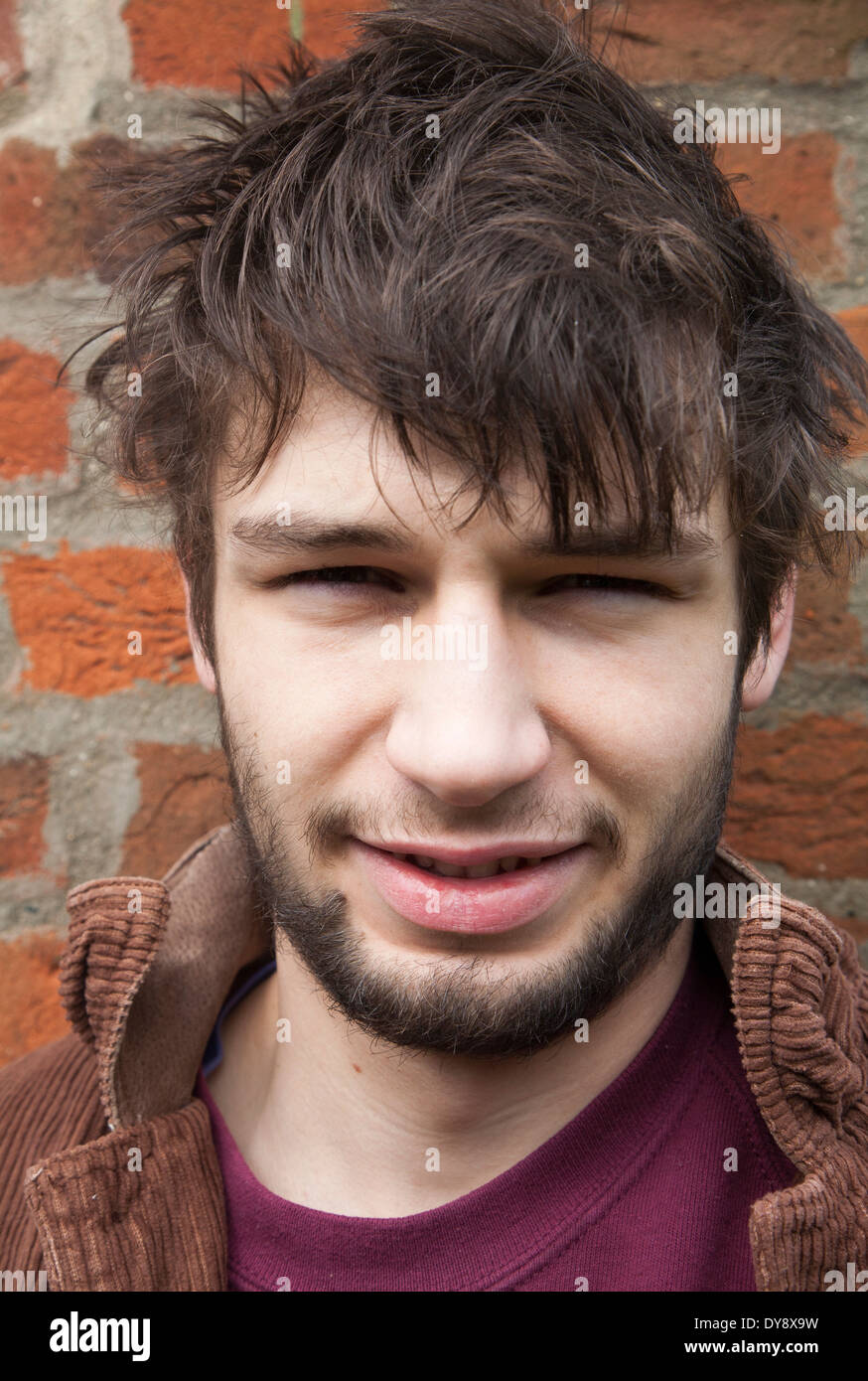 Model released close up portrait of 20 year old man with beard, UK - Stock Image