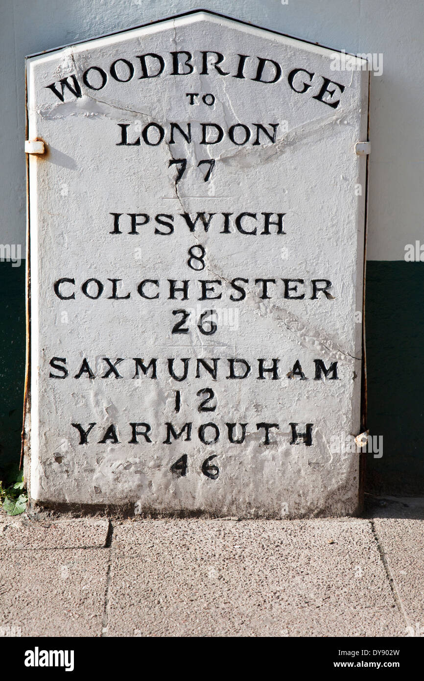 Old mile post marker with distances, Woodbridge, Suffolk, England - Stock Image