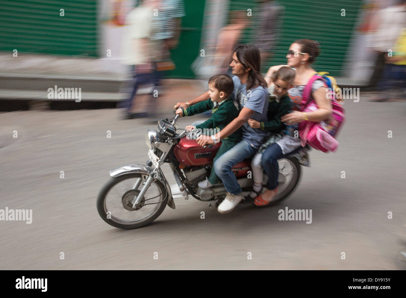 Motorcycle, Motorbike, driving, India, Asia, traffic, transport, family, dangerous, - Stock Image