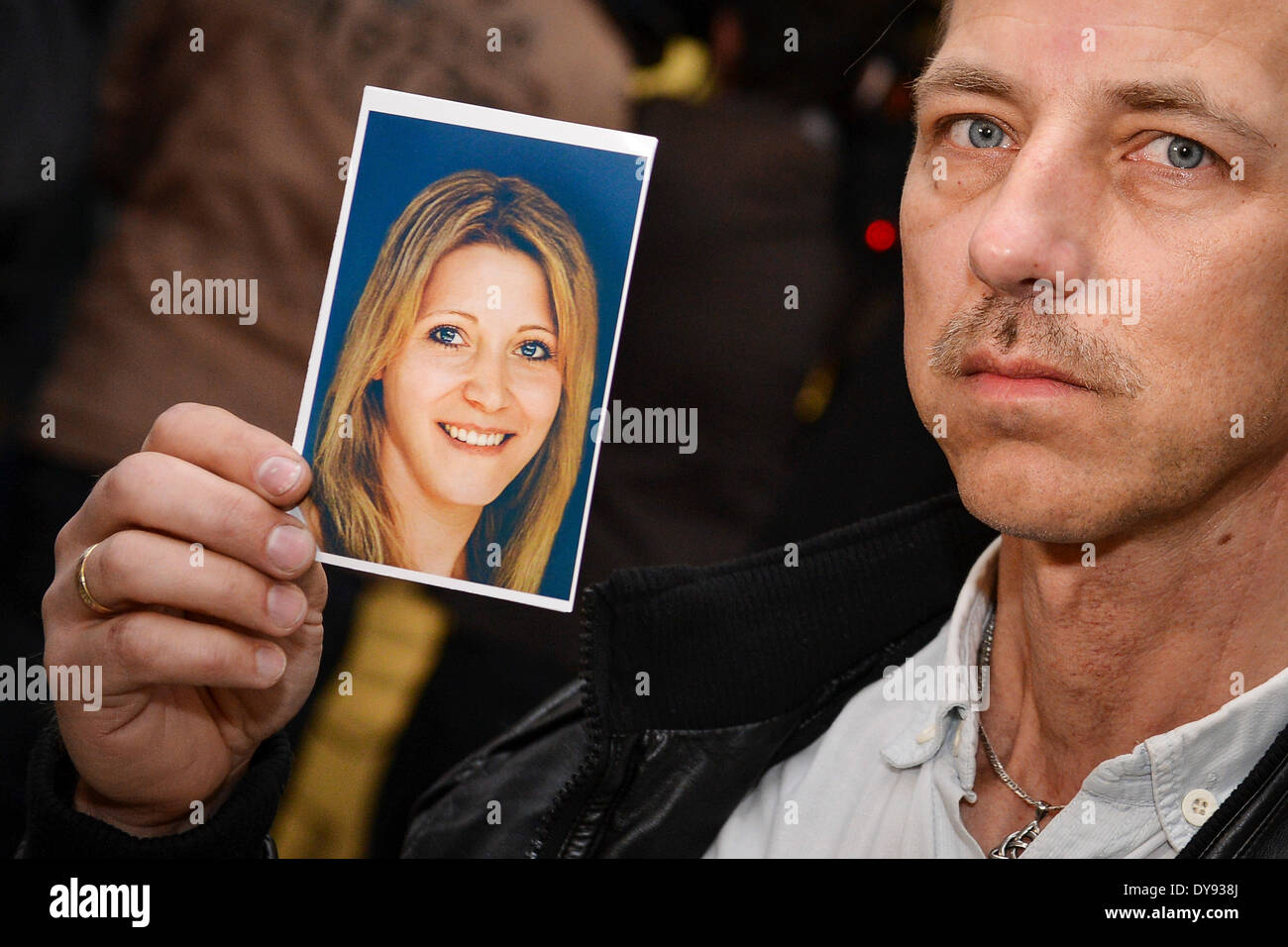Bayreuth, Germany. 10th Apr, 2014. Mario S., the father of Peggy, shows a picture of his daughter how she could look today prior the new hearing of Ulvi K. in the Landcourt in Bayreuth, Germany, 10 April 2014. In 2004 Ulvi K. was convicted because of Peggy's murder. Peggy disappeared in 2001. In the context of the new hearing it should be proved if Ulvi K. is guilty. Photo: David Ebener/dpa/Alamy Live News - Stock Image