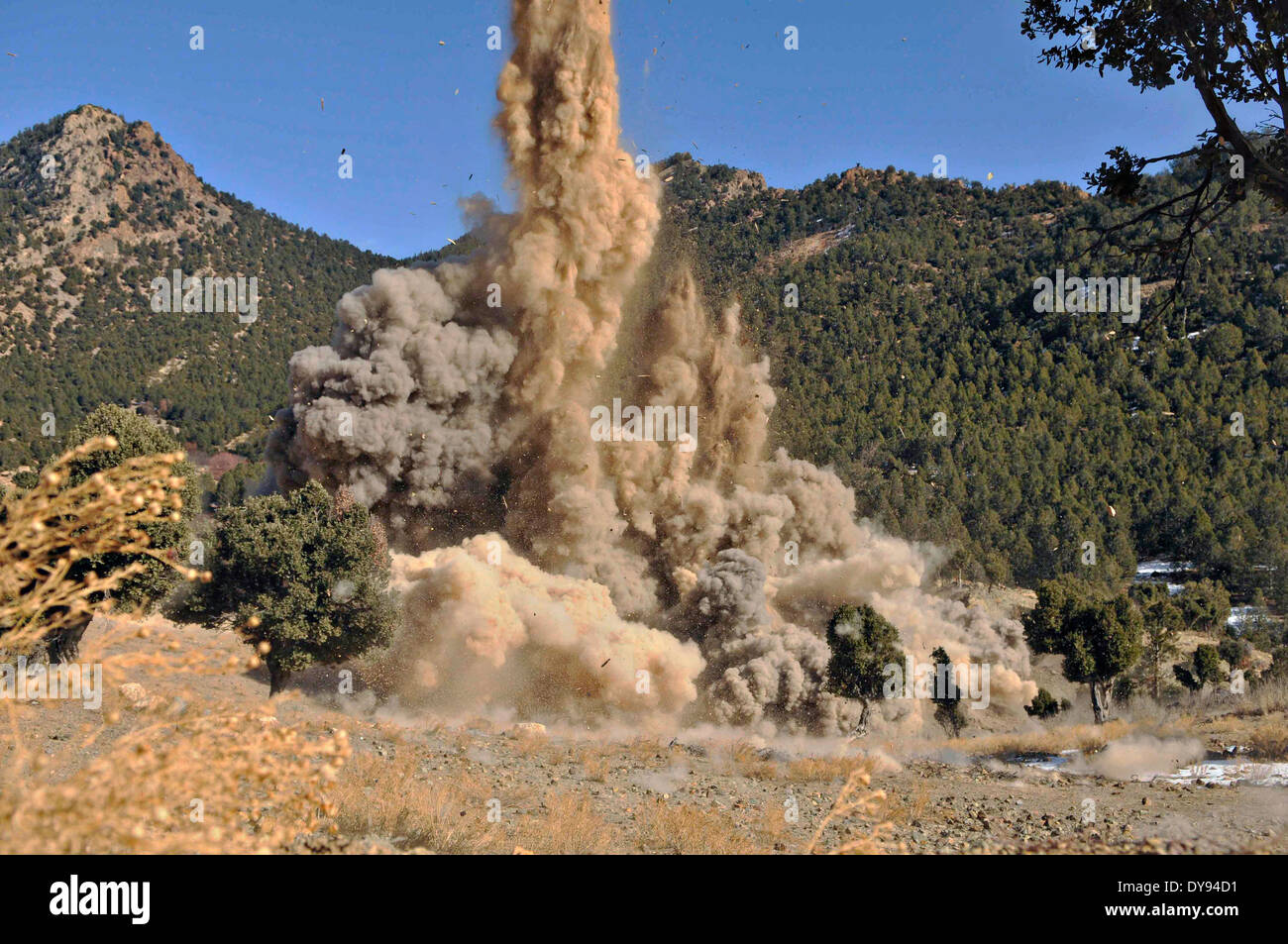 A former Taliban safe house explodes after US Army soldiers placed C-4 explosive charges inside a wall to destroy the building once used by insurgent fighters December 18, 2009 in Khost province, Afghanistan. - Stock Image