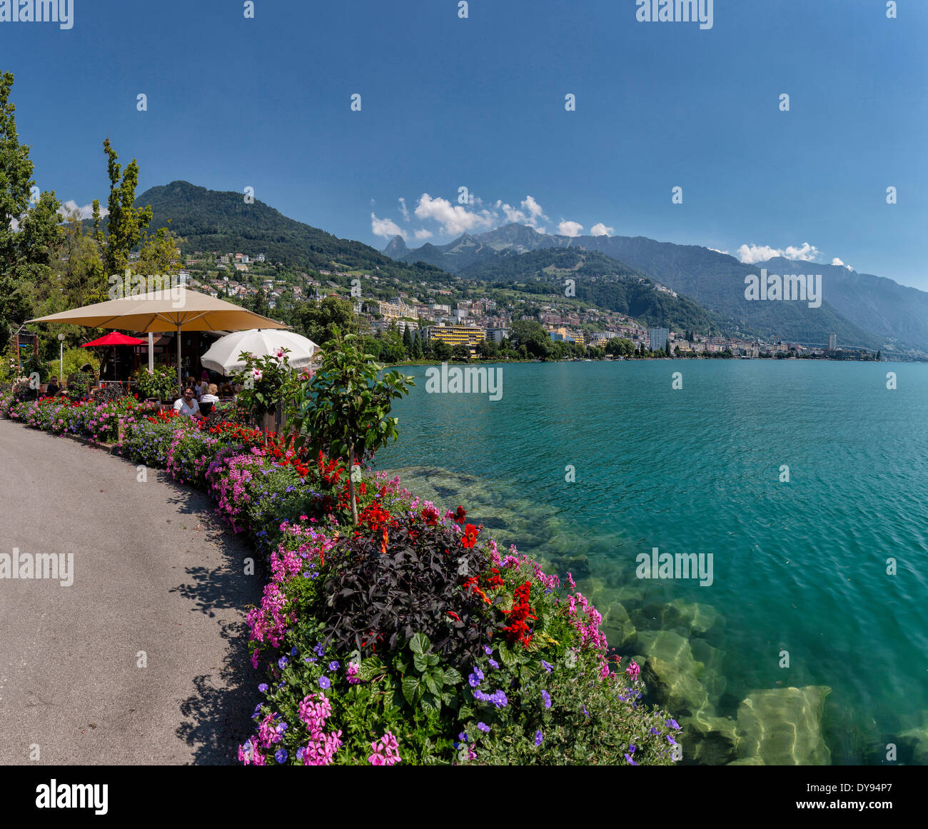 Quai de Clarens promenade lake Geneva Leman town village water flowers summer mountains lake Montreux Vaud Switzerland Europ - Stock Image