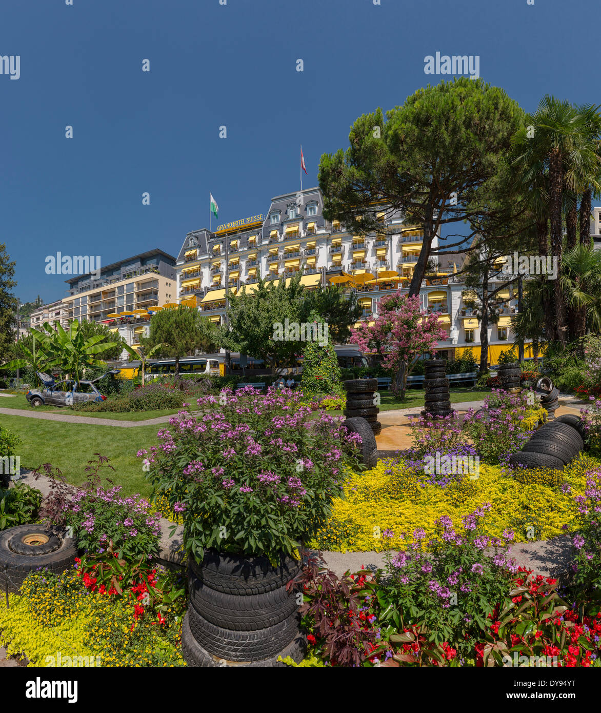 Grand Hotel Suisse hotel park Quai Edouard-Jaccoud town village flowers summer garden park Montreux Vaud Switzerland Europe, - Stock Image