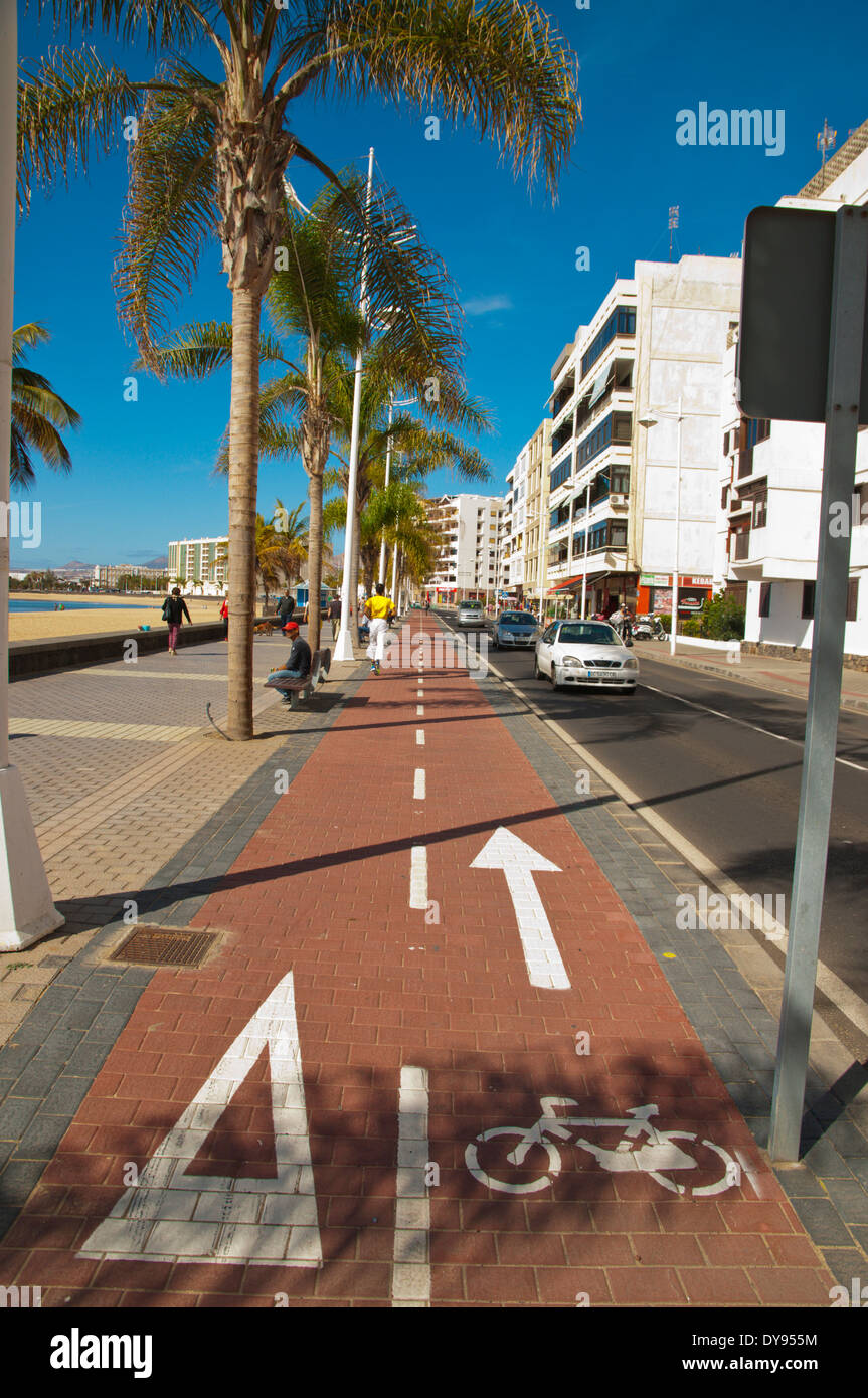 Bicycle lane going past Playa del Reducto beach, Arrecife, Lanzarote, Canary Islands, Spain, Europe - Stock Image