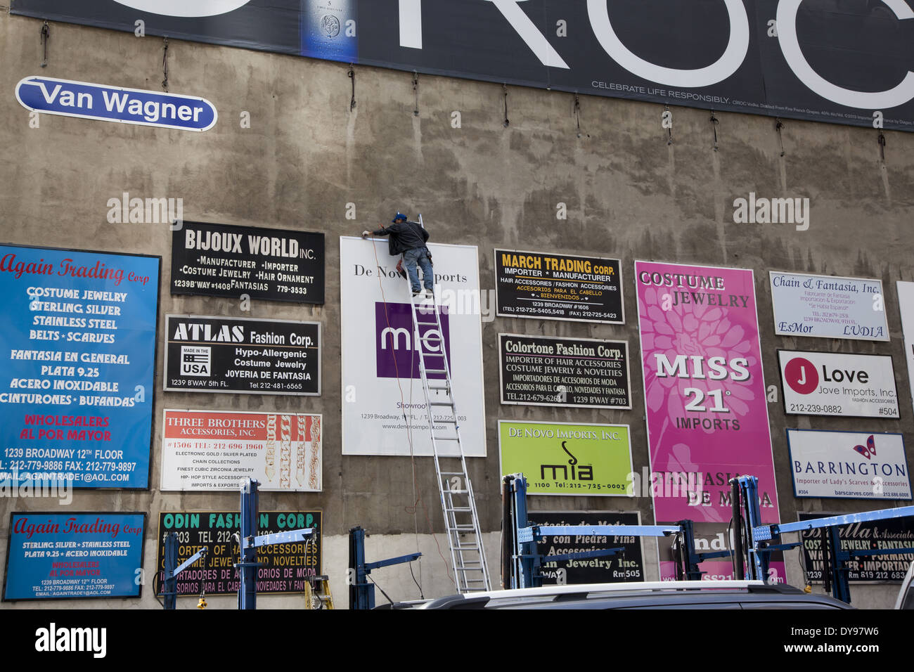 Outdoor Ads on a parking lot wall wall in the fashion district in Manhattan, NYC. - Stock Image