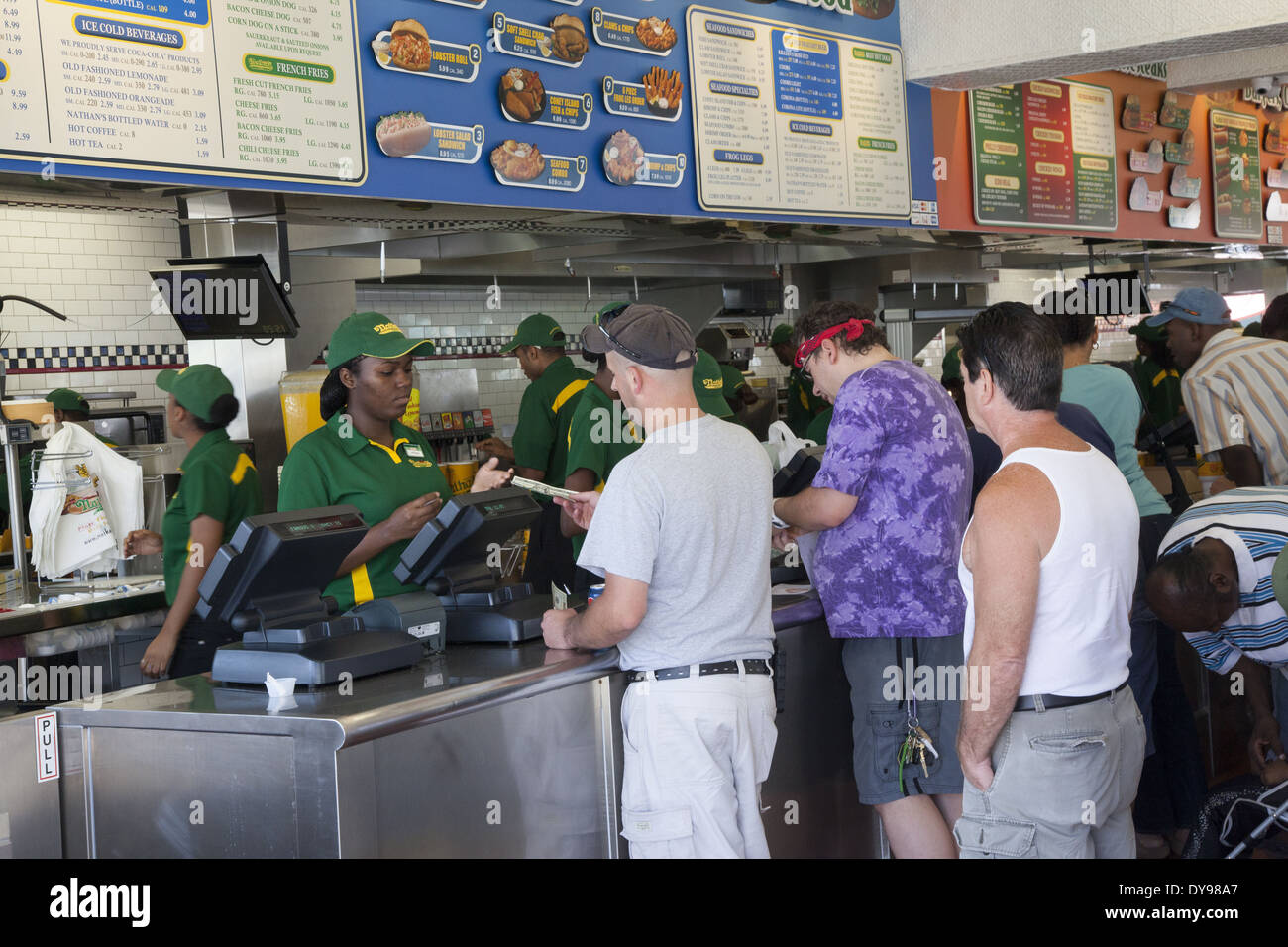 People being served inside the original Nathan's, famous for its hot dogs at Coney Island, Brooklyn, NY. - Stock Image