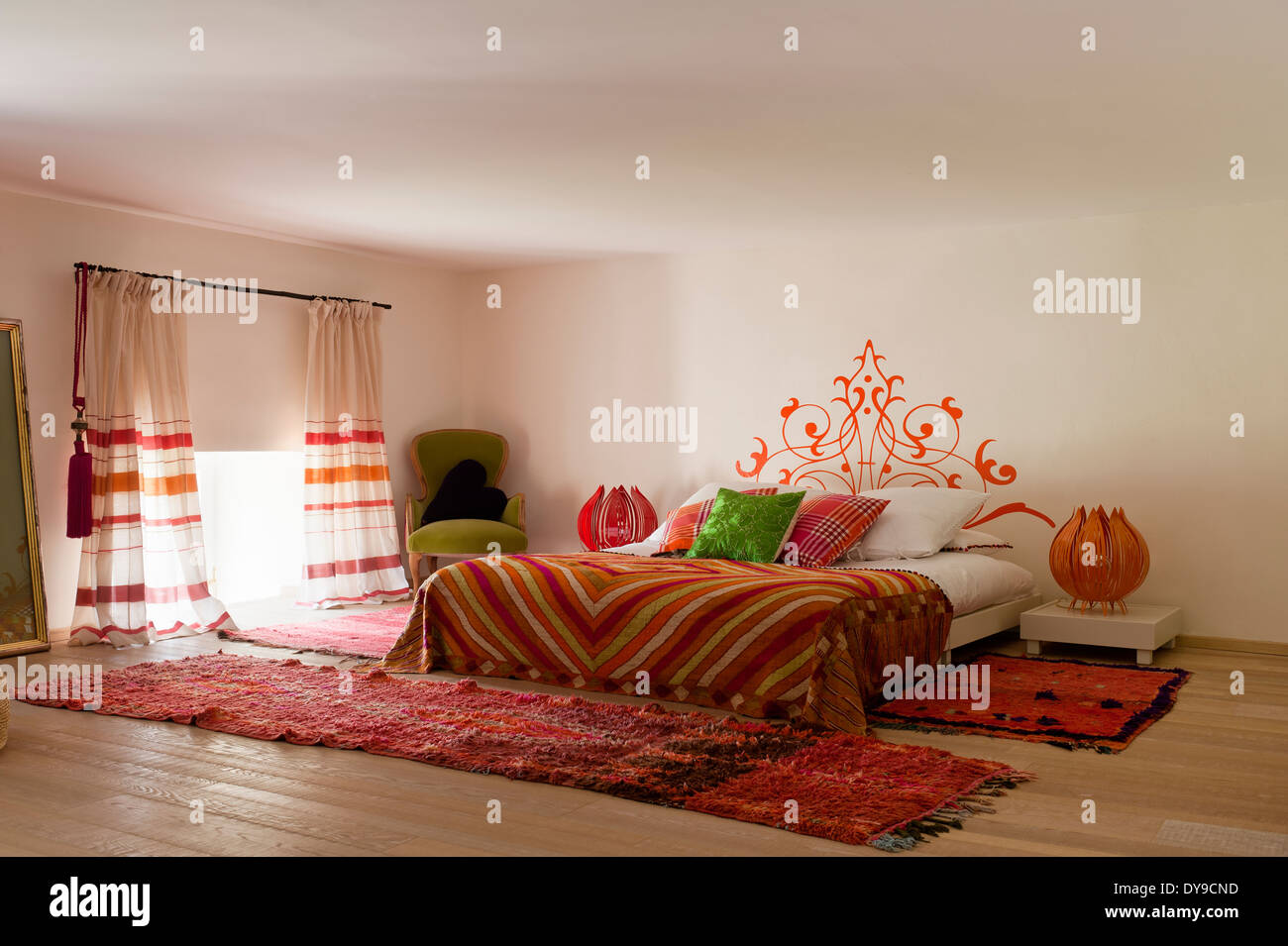 Warm Indian and Moroccan inspired bedroom with brightly ...