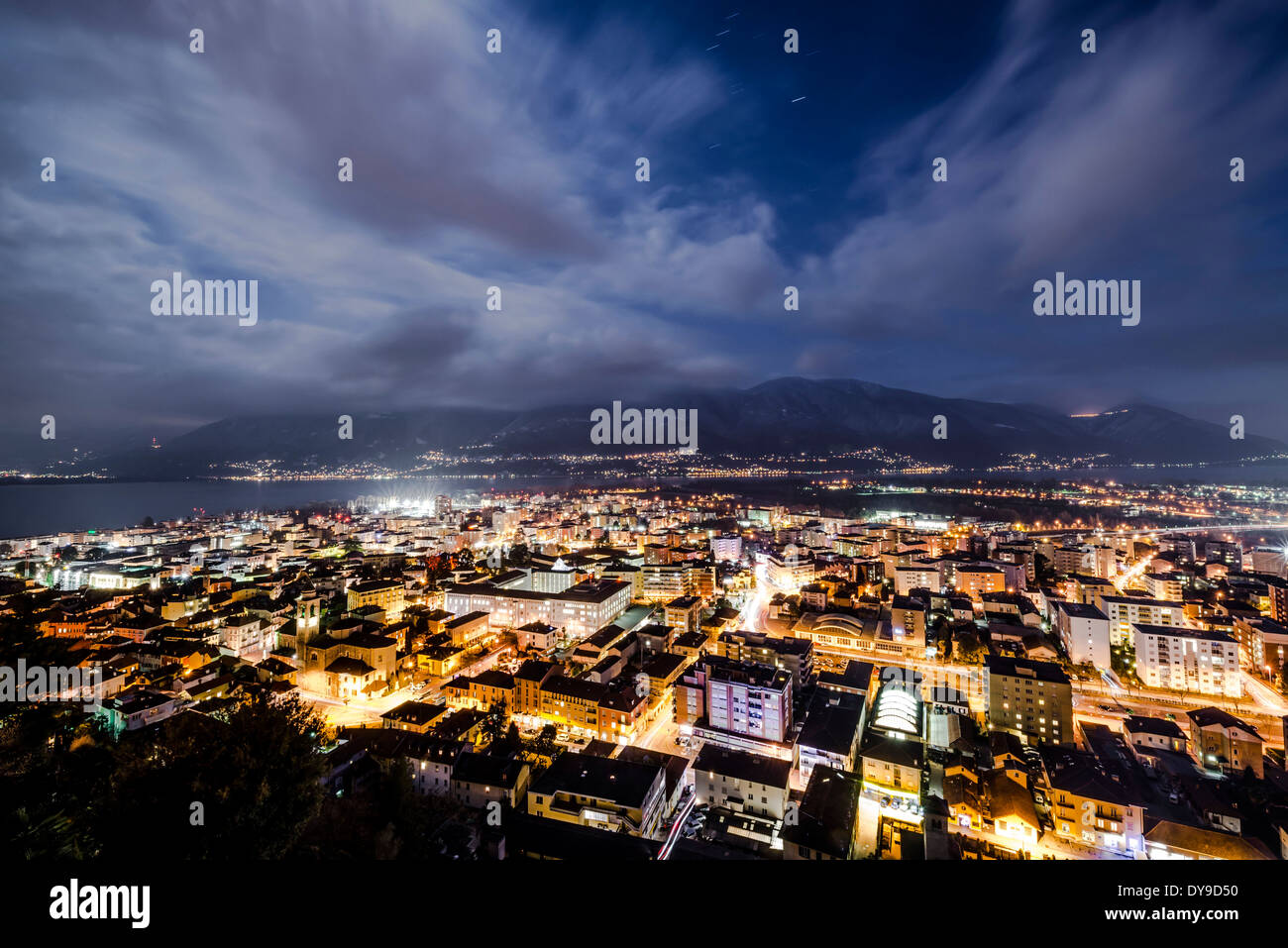 Cityscape in blue hour with mountain and clouds in locarno ticino Switzerland, Europe, - Stock Image