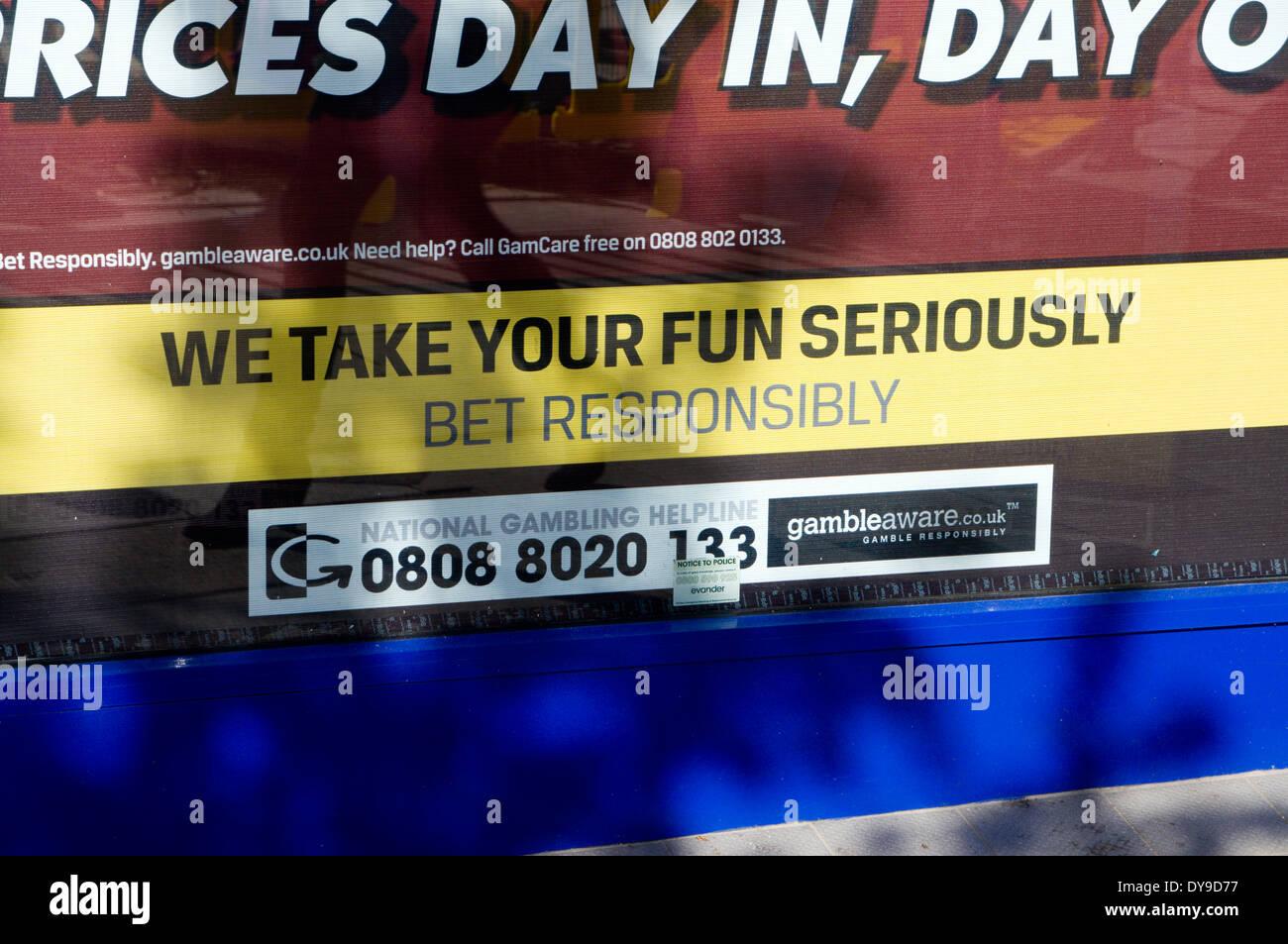 Warning of the dangers of gambling on betting shop window, Cardiff, Wales, UK. - Stock Image