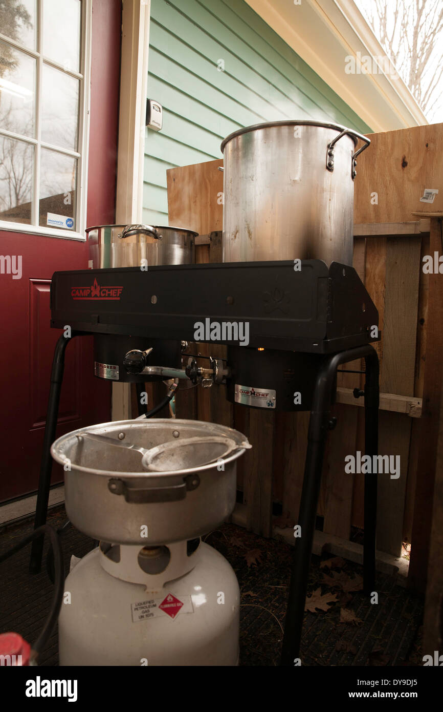 A homemade setup for boiling maple sap to make maple syrup, a common New England activity.