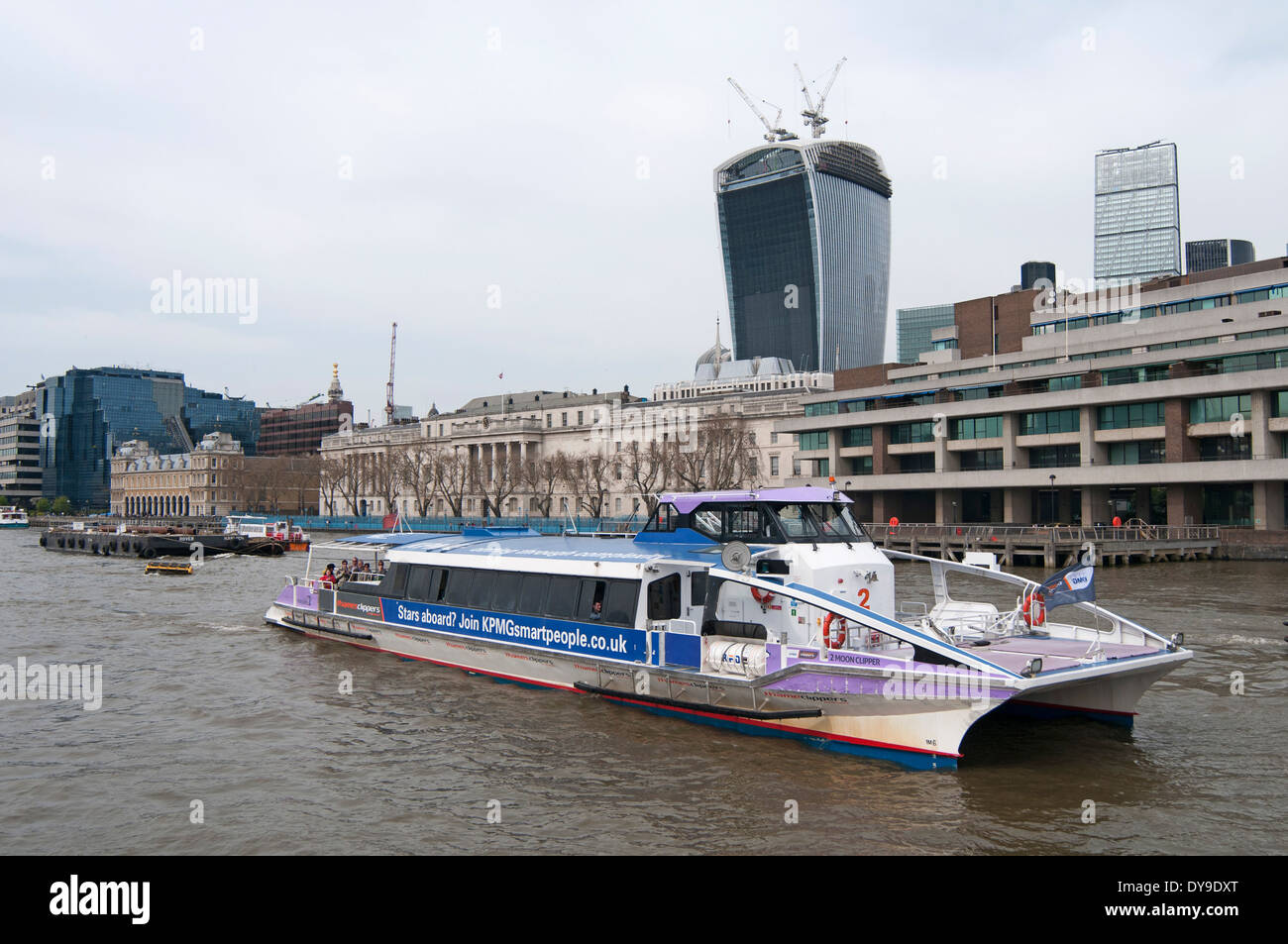Tourist boat sails along the River Thames, London, England, UK - Stock Image