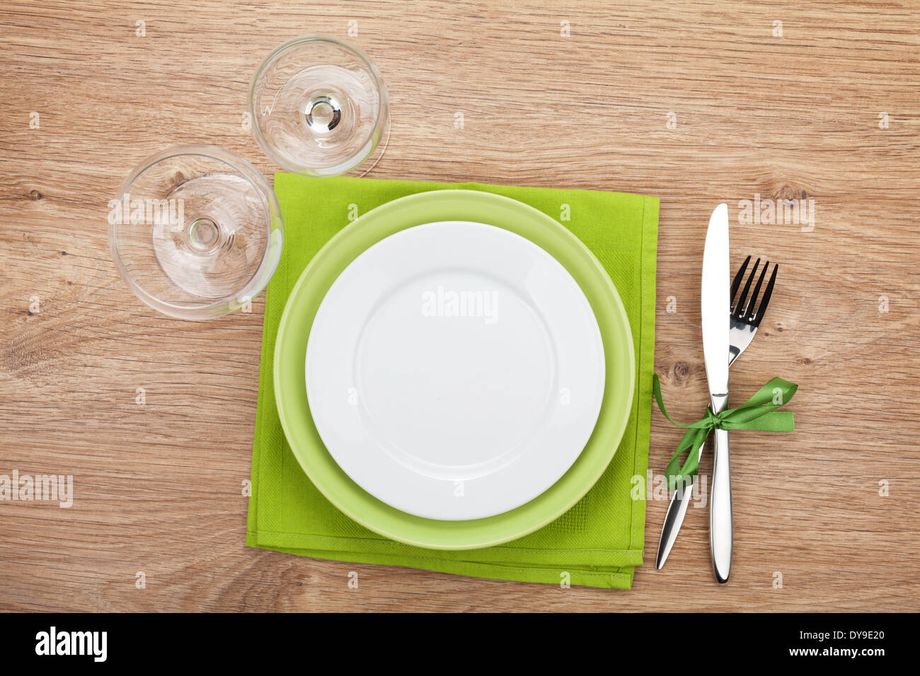 Kitchen utensils over wooden table with copyspace - Stock Image