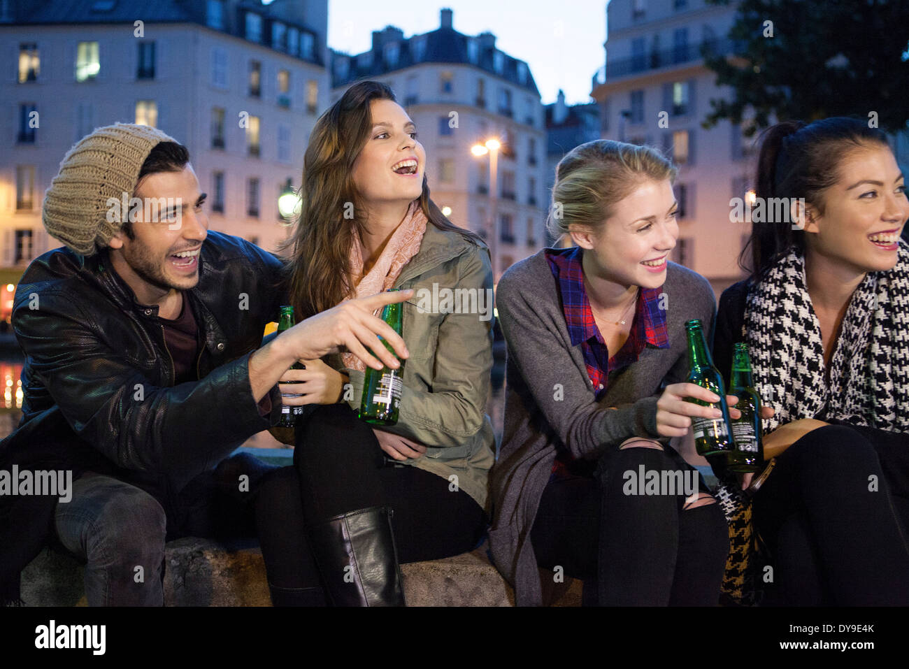 Friends having beers together outdoors - Stock Image
