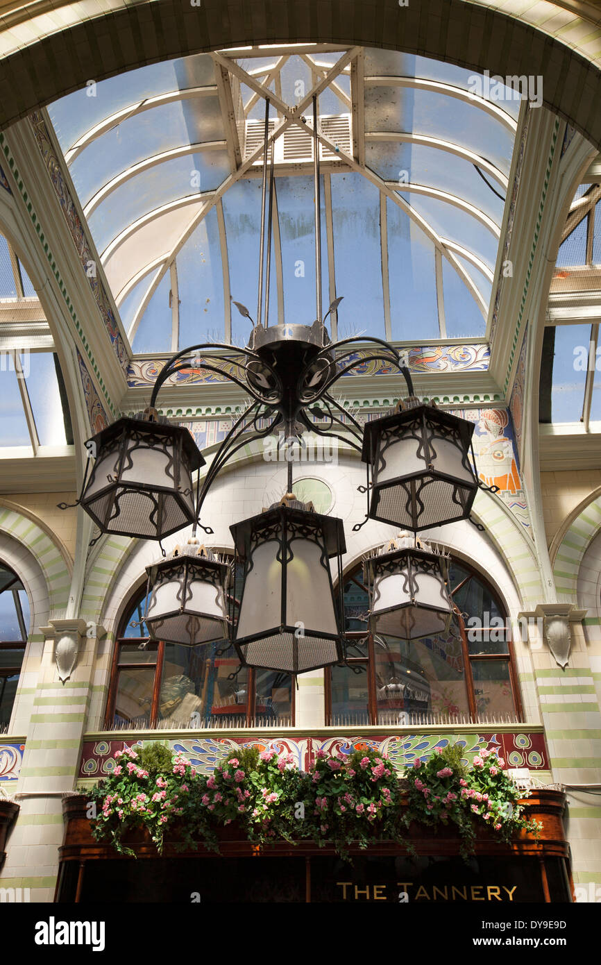 UK, England, Norfolk, Norwich, Royal Arcade, glazed roof and Art Nouveau lighting - Stock Image
