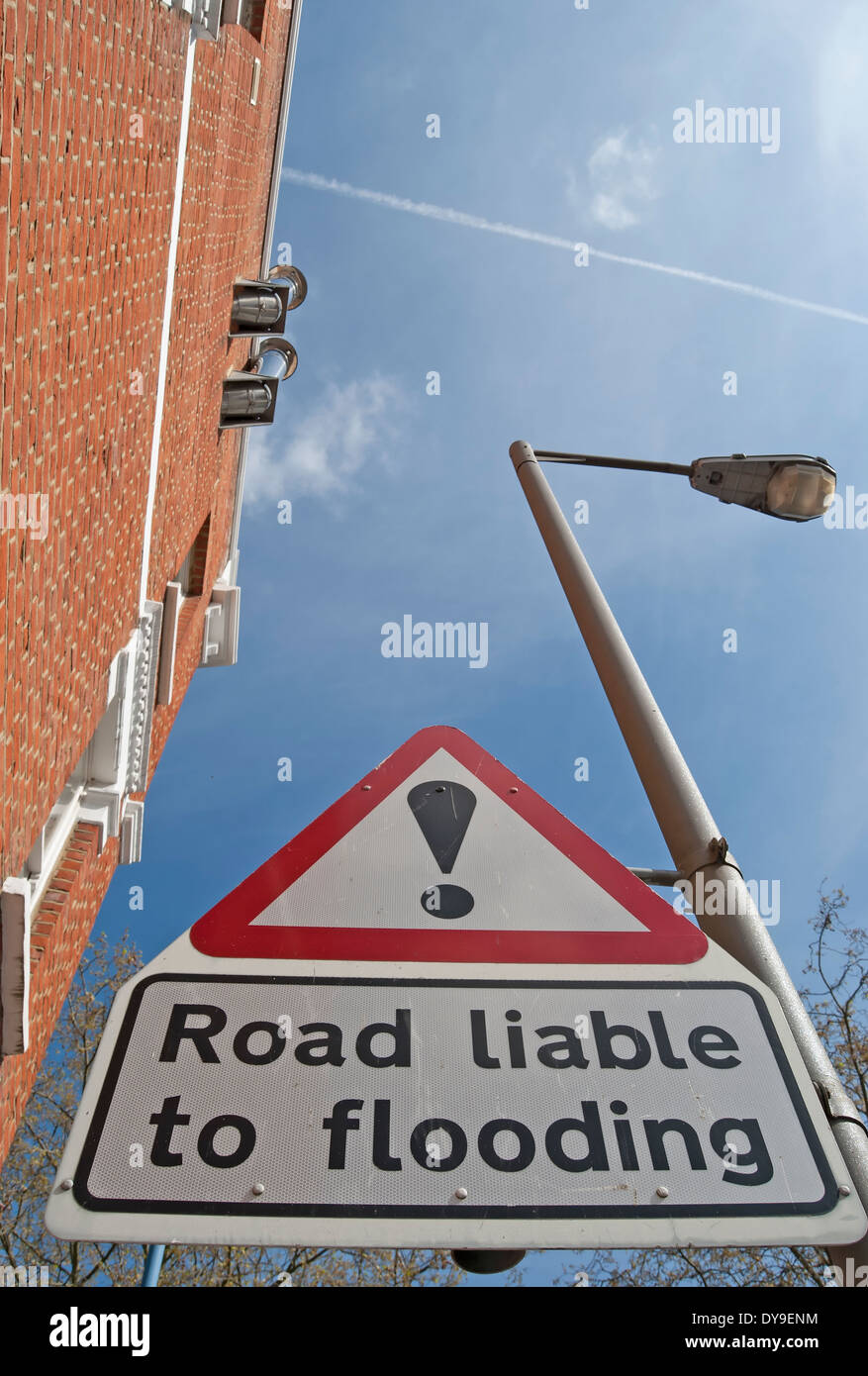 road liable to flooding sign with exclamation mark above, near the river thames at putney, southwest london, england Stock Photo