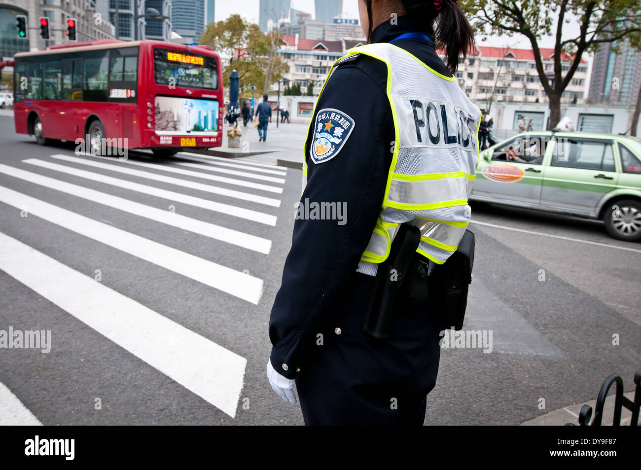 traffic police officer on duty in Shanghai, China - Stock Image