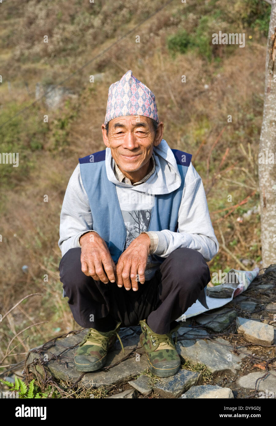 Nepali man wearing traditional Dhaka topi hat, Sarangkot, Nepal. - Stock Image