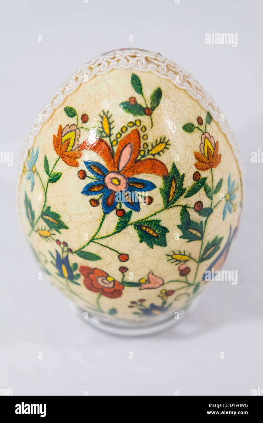 Easter egg decorated with flowers made by decoupage technique on light background Stock Photo