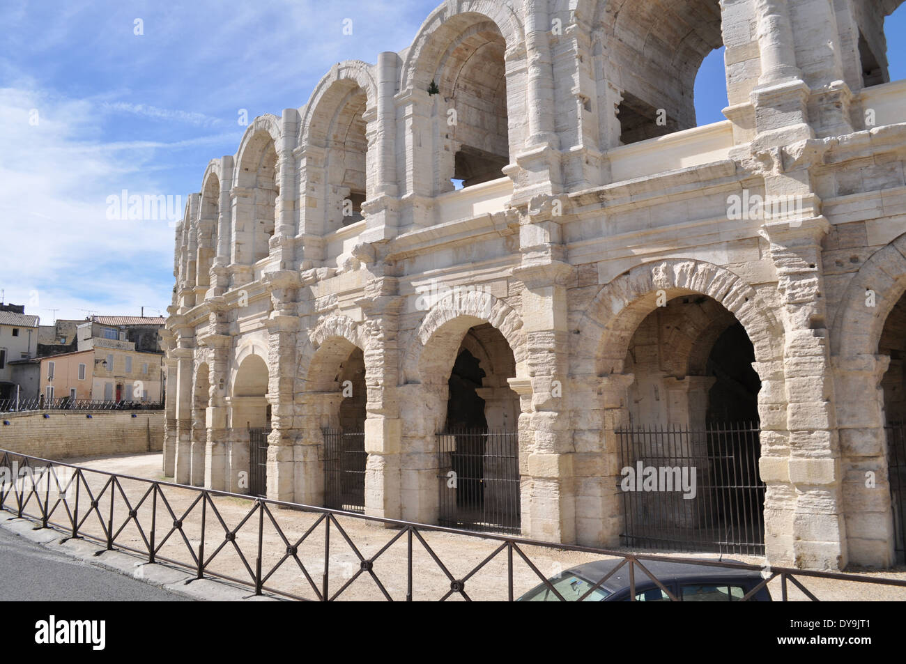 The spruced-up stone-blasted arches of the Roman Amphitheatre in Arles France - Stock Image