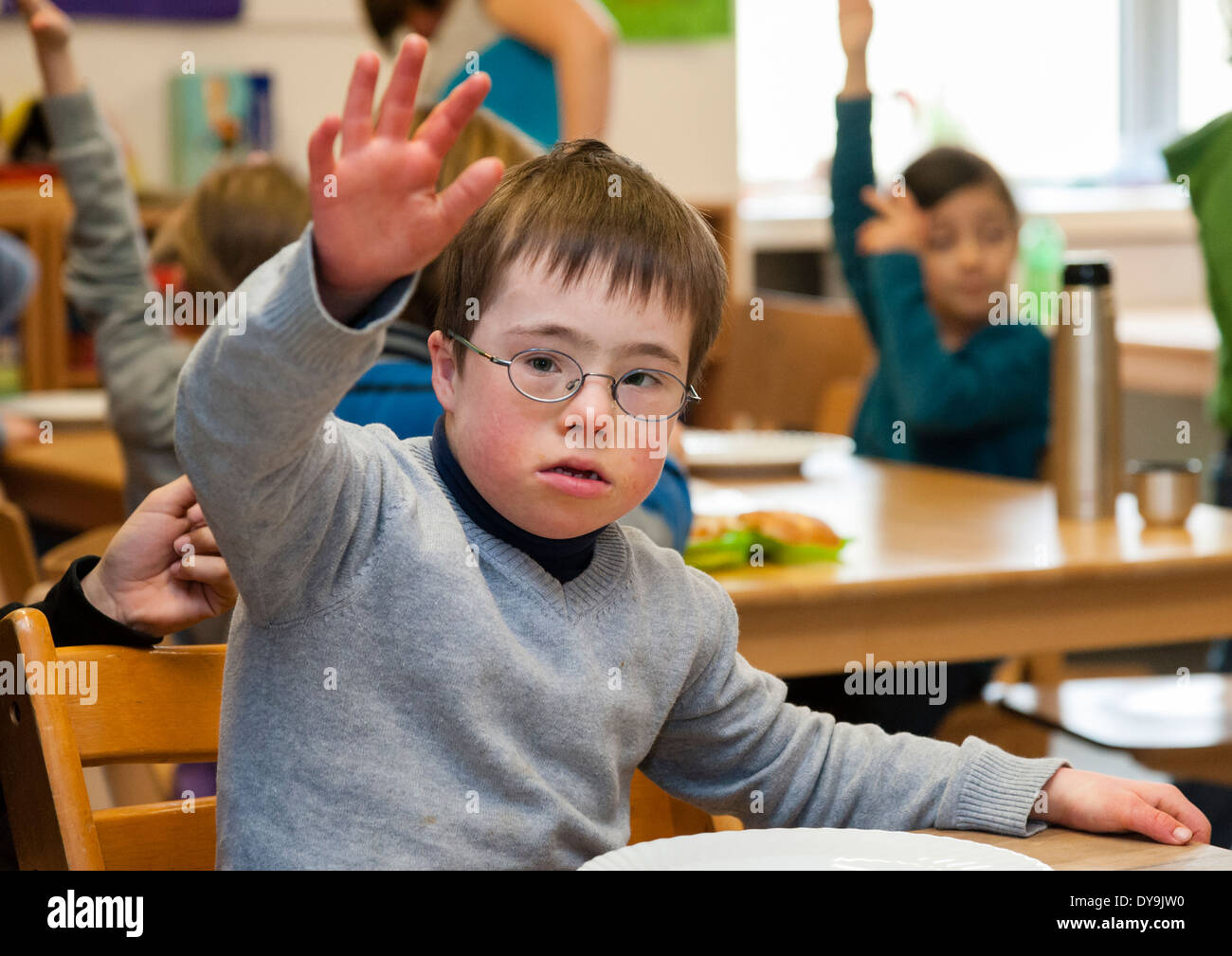 Non-disabled and disabled pupils (in this case a boy suffering from Down's syndrome) learn together in the same class. - Stock Image