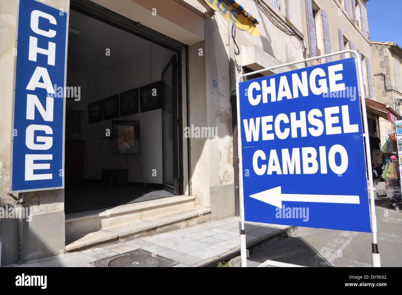 A pavement sidewalk sign outside a bureau de change in arles